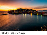 Sunset on the Baia del Silenzio in the fishing village of Sestri Levante... Стоковое фото, фотограф Zoonar.com/fabio lotti / easy Fotostock / Фотобанк Лори