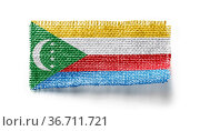 Comoros flag on a piece of cloth on a white background. Стоковое фото, фотограф Zoonar.com/BUTENKOV ALEKSEY / easy Fotostock / Фотобанк Лори