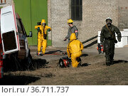 Firefighters in chemical protection suit during the job. Стоковое фото, фотограф Zoonar.com/Volodymyr Khodariev / easy Fotostock / Фотобанк Лори