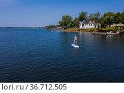 A gorgeous bikini model enjoying a day on the water. Стоковое фото, фотограф Zoonar.com/Walter G Arce Sr Grindstone Media/ASP I / easy Fotostock / Фотобанк Лори