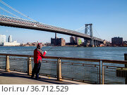 New York, United States of America - November 17, 2016: A man fishing... Стоковое фото, фотограф Zoonar.com/Oliver Foerstner / easy Fotostock / Фотобанк Лори