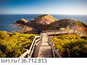 The famous Cape Schanck boardwalk runs towards the sea and rock formation... Стоковое фото, фотограф Zoonar.com/Chris Putnam / easy Fotostock / Фотобанк Лори