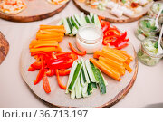 Fresh cucumber, carrot, red and green sweet paprika sliced in stripes... Стоковое фото, фотограф Zoonar.com/Konstantin Malkov / easy Fotostock / Фотобанк Лори