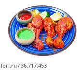 Indian cuisine - portion of Tandoori chicken (spicy chicken legs marinated... Стоковое фото, фотограф Zoonar.com/Valery Voennyy / easy Fotostock / Фотобанк Лори