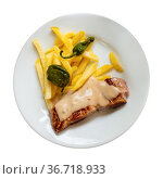 Grilled pork with allioli, french fries and padron peppers. Стоковое фото, фотограф Яков Филимонов / Фотобанк Лори