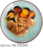 Stewed pig trotters with potato, homemade dinner. Стоковое фото, фотограф Яков Филимонов / Фотобанк Лори
