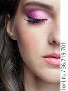 Closeup portrait of female face with red lips and smoky eyes beauty makeup. Стоковое фото, фотограф Serg Zastavkin / Фотобанк Лори