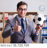 Businessman with football ball in office. Стоковое фото, фотограф Elnur / Фотобанк Лори