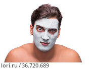 Man with mud mask isolated on white. Стоковое фото, фотограф Elnur / Фотобанк Лори