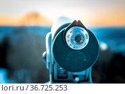 Close up of tourist binocular in Austria, wintertime and sundown. Стоковое фото, фотограф Zoonar.com/Patrick Daxenbichler / easy Fotostock / Фотобанк Лори