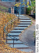 Curved Stairway With Fallen Leaves in Oslo Norway. Стоковое фото, фотограф Zoonar.com/Marko Beric / easy Fotostock / Фотобанк Лори