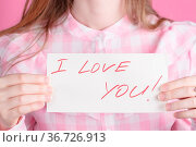 Note in the hands with the words I love you. Стоковое фото, фотограф Zoonar.com/Photographer: Andrey N.Cherkasov / easy Fotostock / Фотобанк Лори