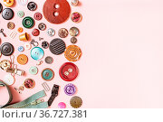 Top view of many sewing objects on pink background with blank copyspace... Стоковое фото, фотограф Zoonar.com/Valery Voennyy / easy Fotostock / Фотобанк Лори