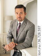 Businessman or director with a mustache in a gray jacket. Стоковое фото, фотограф Ирина Аринина / Фотобанк Лори