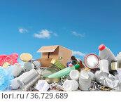 Heap of assorted domestic garbage over blue sky. Стоковое фото, фотограф Zoonar.com/Roman Milert / easy Fotostock / Фотобанк Лори