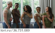 Group of diverse young people showing their vaccinated shoulders at home. Стоковое видео, агентство Wavebreak Media / Фотобанк Лори
