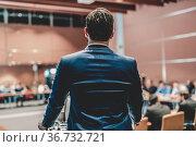 Public speaker giving talk at Business Event. Стоковое фото, фотограф Matej Kastelic / Фотобанк Лори