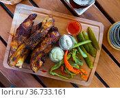 Baked pork ribs with pickles cucumbers and pepper. Стоковое фото, фотограф Яков Филимонов / Фотобанк Лори