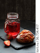 Булочка с клубникой и творогом с вишневым соком на черном фоне. Стоковое фото, фотограф Марина Володько / Фотобанк Лори