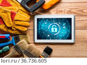 Tablet pc with security concept on screen and industrial tools around. Стоковое фото, фотограф Zoonar.com/Khakimullin Aleksandr D9 / easy Fotostock / Фотобанк Лори