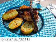 Dish of tasty steak of fried salmon with potatoes and asparagus. Стоковое фото, фотограф Яков Филимонов / Фотобанк Лори