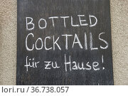 """""""Berlin, Germany - Off-premise offer of a closed cocktail bar due to Corona measures"""" Редакционное фото, агентство Caro Photoagency / Фотобанк Лори"""