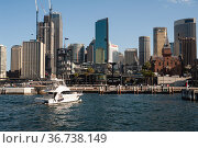 """""""Sydney, Australia, skyline of the business district with Sydney Harbour and boat"""" (2019 год). Стоковое фото, агентство Caro Photoagency / Фотобанк Лори"""