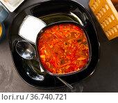 Traditional Russian delicious meat soup Solyanka with sour cream and lemon closeup. Стоковое фото, фотограф Яков Филимонов / Фотобанк Лори