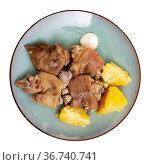 Pig's trotter served on white plate. Стоковое фото, фотограф Яков Филимонов / Фотобанк Лори