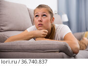 Sad woman is propped her cheeks with hands because she bored. Стоковое фото, фотограф Яков Филимонов / Фотобанк Лори