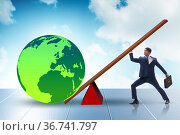 Businessman lifting the earth in challenge concept. Стоковое фото, фотограф Elnur / Фотобанк Лори