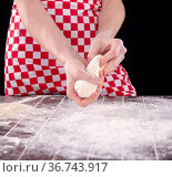 Cook preparing dough for baking in the kitchen. Стоковое фото, фотограф Elnur / Фотобанк Лори