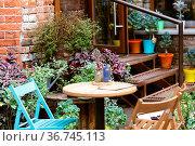 Cozy outdoor cafe in Paris, France. Стоковое фото, фотограф Zoonar.com/Photographer: Andrey N.Cherkasov / easy Fotostock / Фотобанк Лори