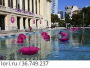 Umbrella in a pool in front of the city hall of Puteaux, Hauts de... Редакционное фото, фотограф Frederic Soreau / age Fotostock / Фотобанк Лори