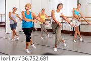 Group of happy women different ages practicing zumba in dance class. Стоковое фото, фотограф Яков Филимонов / Фотобанк Лори