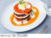 Tasty fried eggplants with tomatoes on white and spicy sauce at plate. Стоковое фото, фотограф Яков Филимонов / Фотобанк Лори