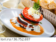 Tasty stack of fried eggplants and tomatoes on spicy sauce served at plate. Стоковое фото, фотограф Яков Филимонов / Фотобанк Лори