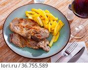 Pork chop with French fries on a plate. Стоковое фото, фотограф Яков Филимонов / Фотобанк Лори