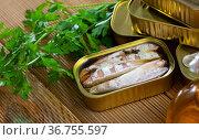 Preserved mackerel fish on wooden table. Стоковое фото, фотограф Яков Филимонов / Фотобанк Лори