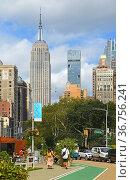Cityscape with Empire State Building in distance. New York City. Редакционное фото, фотограф Валерия Попова / Фотобанк Лори