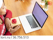 Happy african american plus size woman making christmas video call on laptop with copy space. Стоковое фото, агентство Wavebreak Media / Фотобанк Лори