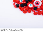 Composition of multiple halloween trick or treat eyeball sweets with copy space on white background. Стоковое фото, агентство Wavebreak Media / Фотобанк Лори