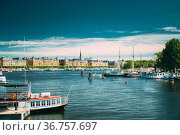 Stockholm, Sweden. Touristic Pleasure Boats Moored Near Piers In Sunny... Стоковое фото, фотограф Ryhor Bruyeu / easy Fotostock / Фотобанк Лори