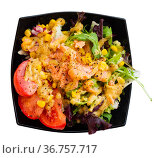 Salad with smoked salmon, tomato, corn, greens. Стоковое фото, фотограф Яков Филимонов / Фотобанк Лори