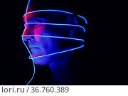 Portrait of man with neon glow lines on his face. Concept cyberpunk... Стоковое фото, фотограф Zoonar.com/Max / easy Fotostock / Фотобанк Лори