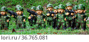 Soldiers doll in green uniform on the gras ander tree. Стоковое фото, фотограф Zoonar.com/Valeriy Shanin / age Fotostock / Фотобанк Лори
