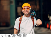 Young disabled man using mobile phone with belt strap artificial prosthetic... Стоковое фото, фотограф Zoonar.com/Max / easy Fotostock / Фотобанк Лори