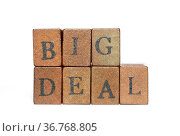 Big deal phrase made from wooden bricks isolated on white. Стоковое фото, фотограф Zoonar.com/Yury Zap / easy Fotostock / Фотобанк Лори