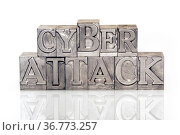 Cyber attack phrase made from metallic letterpress type on reflective... Стоковое фото, фотограф Zoonar.com/Yury Zap / easy Fotostock / Фотобанк Лори