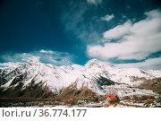 Stepantsminda, Gergeti, Georgia. Villages And Peak Of Mount Kazbek... Стоковое фото, фотограф Ryhor Bruyeu / easy Fotostock / Фотобанк Лори
